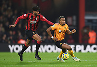 23rd November 2019; Vitality Stadium, Bournemouth, Dorset, England; English Premier League Football, Bournemouth Athletic versus Wolverhampton Wanderers; Adama Traore of Wolverhampton Wanderers goes round Philip Billing of Bournemouth - Strictly Editorial Use Only. No use with unauthorized audio, video, data, fixture lists, club/league logos or 'live' services. Online in-match use limited to 120 images, no video emulation. No use in betting, games or single club/league/player publications