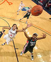 Jan. 6, 2011; Charlottesville, VA, USA; Virginia Cavaliers center Simone Egwu (4) reaches for the rebound with Miami Hurricanes forward Sylvia Bullock (34) during the game at the John Paul Jones Arena. Miami won 82-73. Mandatory Credit: Andrew Shurtleff