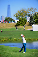 Hideki Matsuyama (JPN) hits his approach shot on 4 with the New York skyline in the background during round 1 foursomes of the 2017 President's Cup, Liberty National Golf Club, Jersey City, New Jersey, USA. 9/28/2017.<br /> Picture: Golffile | Ken Murray<br /> ll photo usage must carry mandatory copyright credit (&copy; Golffile | Ken Murray)