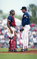 Boston Red Sox catcher Tony Pena and pitcher Roger Clemens during spring training circa 1992 at Chain of Lakes Park in Winter Haven, Florida.  (MJA/Four Seam Images)