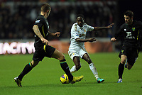 Saturday, 08 December 2012<br /> Pictured: Nathan Dyer of Swansea (C) against Wes Hoolahan (L) and Anthony Pilkington (R) of Norwich<br /> Re: Barclays Premier League, Swansea City FC v Norwich City at the Liberty Stadium, south Wales.