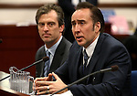 Actor Nicolas Cage testified in support of a bill proposing tax incentives to filmmakers at the Legislative Building Carson City, Nev., on Tuesday, May 7, 2013. Proponents of the measure say it will bring jobs and revenue to the state. Cage's agent Michael Nilon is at left. (AP Photo/Cathleen Allison)