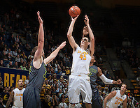 David Kravish of California shoots the ball during the game against UC Irvine at Haas Pavilion in Berkeley, California on December 2nd, 2013.  California defeated UC Irvine, 73-56.