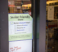 A sign at the entrance of a drug store in the New York neighborhood of Chelsea on Saturday, September 20, 2014 announces that the establishment is a senior friendly store.  Amenities include seating, water, restroom facilities and most important, senior discounts. (© Richard B. Levine)