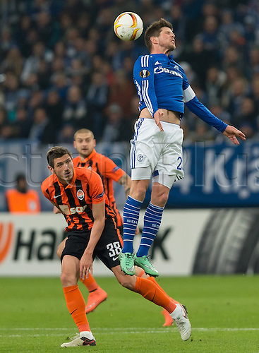 25.02.2016. Gelsenkirchen, Germany.  Schalke's Klaas-Jan Huntelaar (r) and Shakhtar's Sergiy Kryvtsov in action during the Europa League Round of 32 Second Leg soccer match between Schalke 04 and FC Shakhtar Donetsk in the Veltins Arena in Gelsenkirchen, Germany, 25 February 2016.