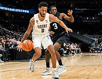 WASHINGTON, DC - JANUARY 28: Jahvon Blair #0 of Georgetown pushes on past Kamar Baldwin #3 of Butler during a game between Butler and Georgetown at Capital One Arena on January 28, 2020 in Washington, DC.