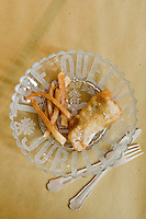 A portion of fish and chips prepared by chef Maddalena Caruso and served on a glass plate commemorating Queen Victoria's Jubilee