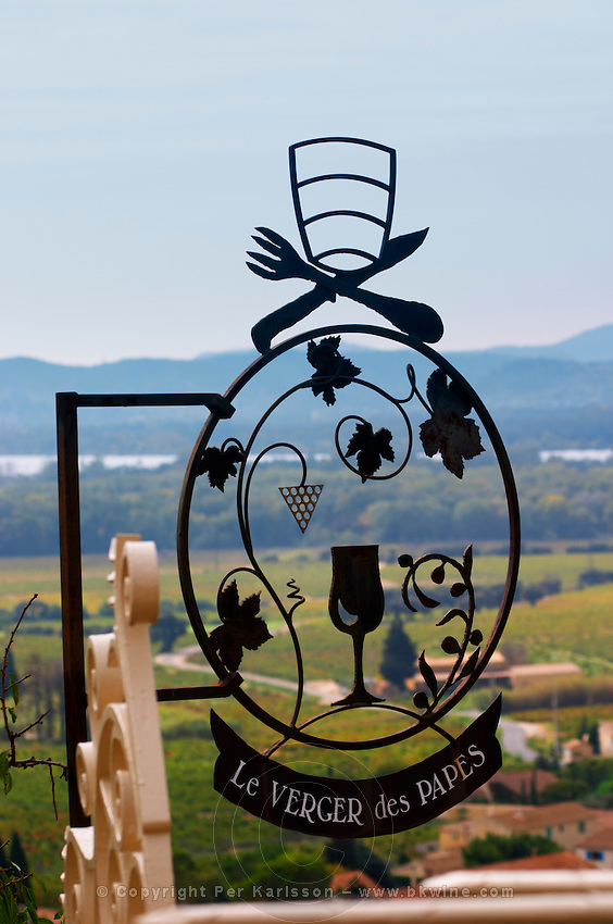 A wrought iron sign with a wine glass grape bunch, vine, The restaurant Le Verger de Papes in Chateauneuf-du-Pape Vaucluse, Provence, France, Europe