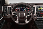 Car pictures of steering wheel view of a 2016 GMC Sierra 1500 Denali 4WD Crew Cab Short Box Denali 4 Door Pick-up Steering Wheel