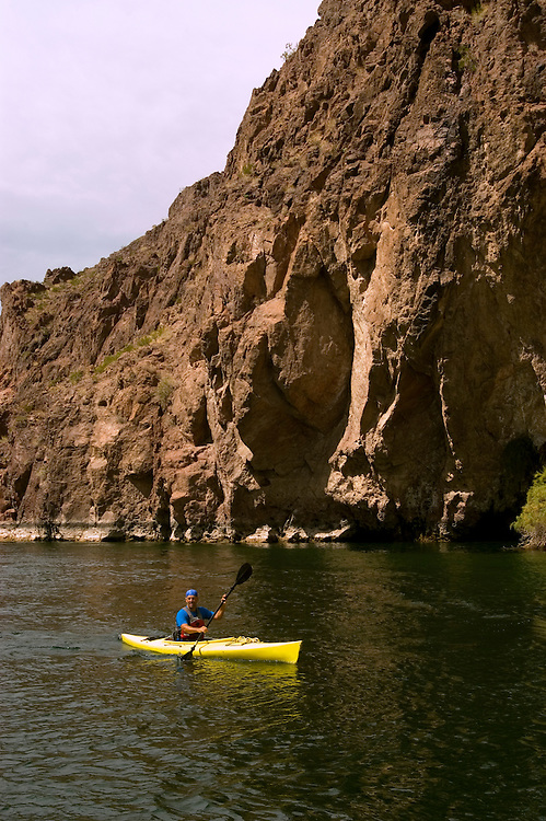 Kayaking, no model release, on the Colorado River below Hoover Dam on border of Arizona, AZ, Nevada, NV, tourism, vacation, sports, action, sky, water, mountain, landscape, image nv426-18500.Photo copyright: Lee Foster, www.fostertravel.com, lee@fostertravel.com, 510-549-2202