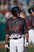 San Jose Giants right fielder Johneshwy Fargas (49) walks towards the dugout during a California League game against the Lancaster JetHawks at San Jose Municipal Stadium on May 12, 2018 in San Jose, California. Lancaster defeated San Jose 7-6. (Zachary Lucy/Four Seam Images)