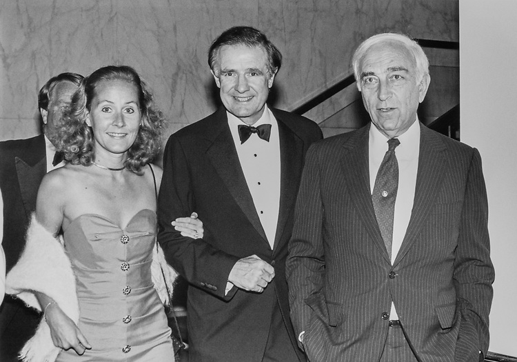 Lori Riegle, Sen. Donald W. Riegle, D-Mich., and Sen. Frank Lautenberg, D-N.J., at Democratic Senatorial Campaign Committee dinner, entering ballroom for dinner on Oct. 1, 1990. (Photo by Laura Patterson/CQ Roll Call)