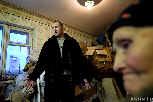 Nina Merzlikina, 75, and Sergei Kostenko, 45, have packed up their belongings at this apartment in Yor Shor village in expectation of eviction by bailiffs. Local officials want to close the village, near Vorkuta town, so they can shut off supplies of gas and electricity..Vorkuta is a coal mining and former Gulag town 1,200 miles north east of Moscow, beyond the Arctic Circle, where temperatures in winter drop to -50C. .Here, whole villages are being slowly deserted and reclaimed by snow, while the financial crisis is squeezing coal mining companies that already struggle to find workers..Moscow says its Far North is a strategic region, targeting huge investment to exploit its oil and gas resources. But there is a paradox: the Far North is actually dying. Every year thousands of people from towns and cities in the Russian Arctic are fleeing south. The system of subsidies that propped up Siberia and the Arctic in the Soviet times has crumbled. Now there's no advantage to living in the Far North - salaries are no higher than in central Russia and prices for goods are higher.