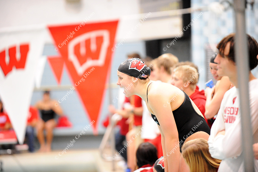 The Wisconsin swim team cheers on their swimmers during UW Swimming and Diving Senior Day on Thursday at the UW Natatorium in Madison