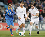 Getafe's Angel Lafita (l) and Real Madrid's Carlos Henrique Casemiro (c) and Xabi Alonso during La Liga match.February 16,2014. (ALTERPHOTOS/Acero)