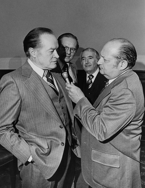 Actor Bob Hope, interviewed by House Press Gallery. Behind are Rep. Walter Flowers, D-Ala., and Rep. Peter W. Rodino, D-N.J. (Photo by Dev O'Neil/CQ Roll Call via Getty Images)