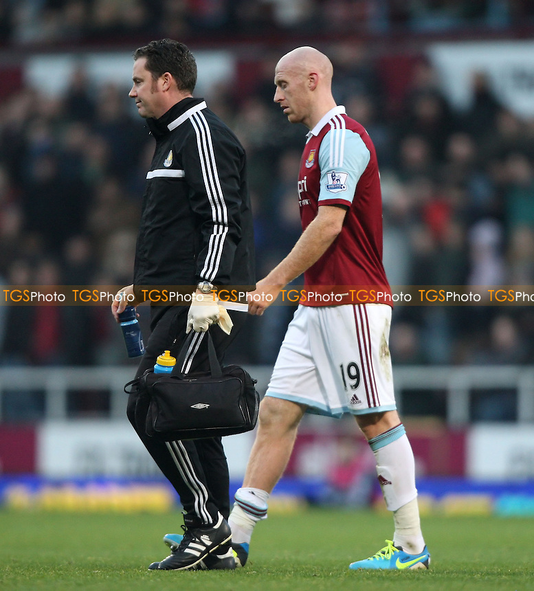 James Collins of West Ham limps off with an injury - West Ham United vs Arsenal, Barclays Premier League at Upton Park, West Ham - 26/12/13 - MANDATORY CREDIT: Rob Newell/TGSPHOTO - Self billing applies where appropriate - 0845 094 6026 - contact@tgsphoto.co.uk - NO UNPAID USE