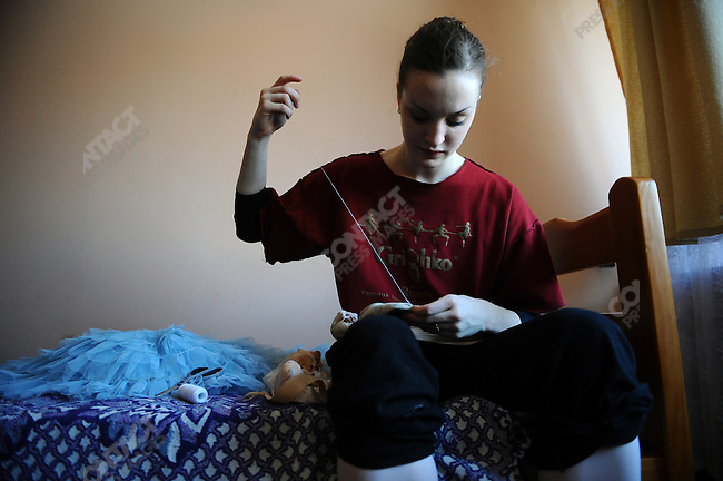 Joy Womack, an American student at the Moscow State Academy of Choreography, the main school feeding dancers to the Bolshoi Ballet and one of the top ballet schools in the world, stitched up a pair of pointes in her room. Moscow, Russia, March 10, 2010
