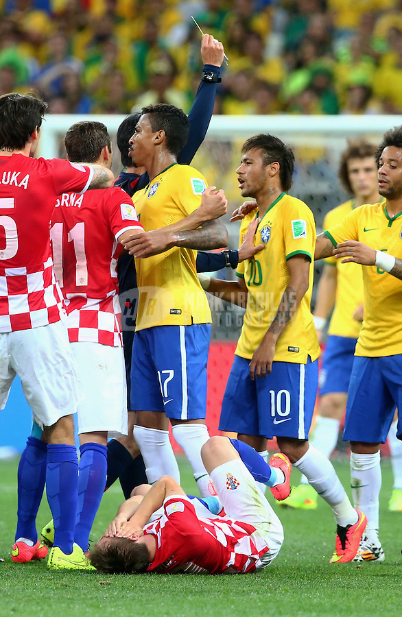 Jun 12, 2014; Sao Paulo, BRAZIL; Brazil forward Neymar (right) reacts after getting a yellow card after colliding with Croatia midfielder Luka Modric in the first half of the opening game of the 2014 World Cup at Arena Corinthians. Mandatory Credit: Mark J. Rebilas-USA TODAY Sports