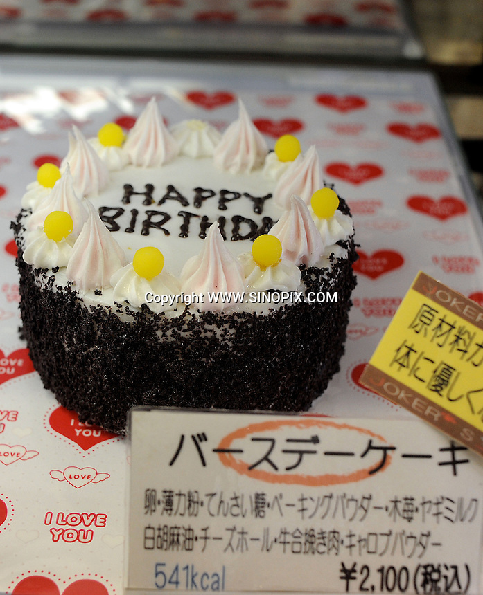 A dog birthday cake cake for sale in a cafe called Deco's Dog Cafe that sells dog snacks including cakes and other snacks in Tokyo, Japan. <br /> 20-Jan-2011