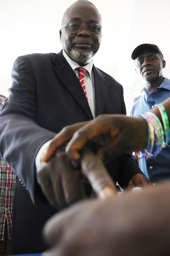 Bissau/June 28 - Presidential candidate for Guinea-Bissau Malam Bacai Sanha dips his finger in ink after voting in the country's elections on June 28. The election comes four months after the leader João Bernardo Vieira was killed by mutinous troops.