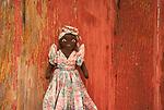 Shoshoni, Wyoming Rag Doll against red barnboard.