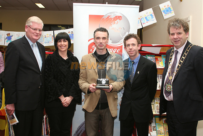 """Frank Maher chose Derek McAuley's """"In a Spin"""" as his personal favourite photo in the Exhibition and presented him with the Joan Wakelin Trophy.  Pictured here with Elaine Grennan of Beverage Business Solutions, Colin Bell and Mayor Michael O'Dowd at the Launch of the Drogheda Photographic Club's Annual Exhibition in Drogheda Library, Stockwell Street...Photo NEWSFILE/Jenny Matthews.(Photo credit should read Jenny Matthews/NEWSFILE)....This Picture has been sent you under the condtions enclosed by:.Newsfile Ltd..The Studio,.Millmount Abbey,.Drogheda,.Co Meath..Ireland..Tel: +353(0)41-9871240.Fax: +353(0)41-9871260.GSM: +353(0)86-2500958.email: pictures@newsfile.ie.www.newsfile.ie.FTP: 193.120.102.198."""