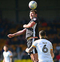 Lincoln City's Matt Rhead gets above Port Vale's Antony Kay<br /> <br /> Photographer Andrew Vaughan/CameraSport<br /> <br /> The EFL Sky Bet League Two - Port Vale v Lincoln City - Saturday 14th April 2018 - Vale Park - Burslem<br /> <br /> World Copyright &copy; 2018 CameraSport. All rights reserved. 43 Linden Ave. Countesthorpe. Leicester. England. LE8 5PG - Tel: +44 (0) 116 277 4147 - admin@camerasport.com - www.camerasport.com