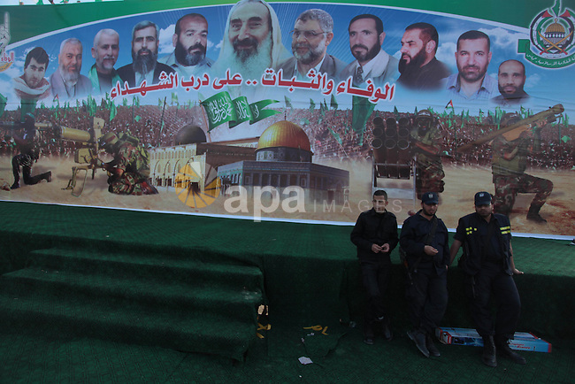 Palestinian Policemen stand guard during the preparation of the Hamas festival in Gaza City, March 22, 2014. Hamas organized a festival in the anniversary of the death of Hamas leaders Sheikh Ahmed Yassin, Ibrahim Makadmeh, and Abdul Aziz Rantisi. Photo by Ashraf Amra