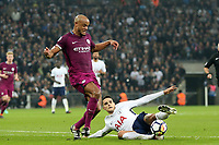 Vincent Kompany of Manchester City and Erik Lamela of Tottenham Hotspur during Tottenham Hotspur vs Manchester City, Premier League Football at Wembley Stadium on 14th April 2018