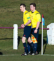 Referee Barry Reid has a discussing with assistant Kieran Green before giving the Whitehill penalty.