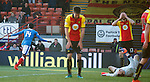 Joe Dodoo runs to celebrate his winner as Partick Thistle are dejected