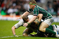 Photo: Richard Lane/Richard Lane Photography. .England v Ireland. RBS Six Nations. 15/03/2008. England's Tom Croft is tackled by Ireland's Jamie Heaslip and Tommy Bowe.