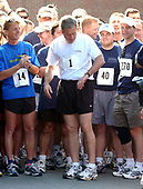 Washington, DC - June 22, 2002 -- United States President George W. Bush checks his watch just before he begins his run as part of the President's Fitness Challenge at Fort McNair in Washington on 22 June, 2002.<br /> Credit: Ron Sachs / Pool via CNP