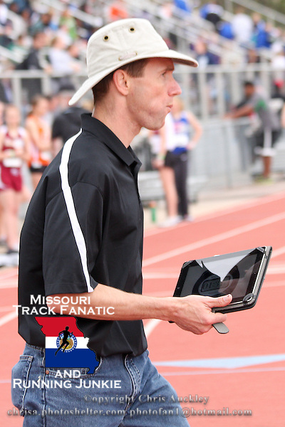 Former Mizzou coach and current Owensville High School coach Matt Candrl uses a stop watch on his tablet computer to keep time at the 2012 Missouri Relays.