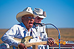 A country and western singer entertains the parade watchers from a float in the Crow Fair parade.