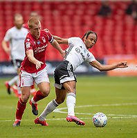 7th July 2020; City Ground, Nottinghamshire, Midlands, England; English Championship Football, Nottingham Forest versus Fulham; Ben Watson (C) of Notts Forest held off by Bobby Reid of Fulham