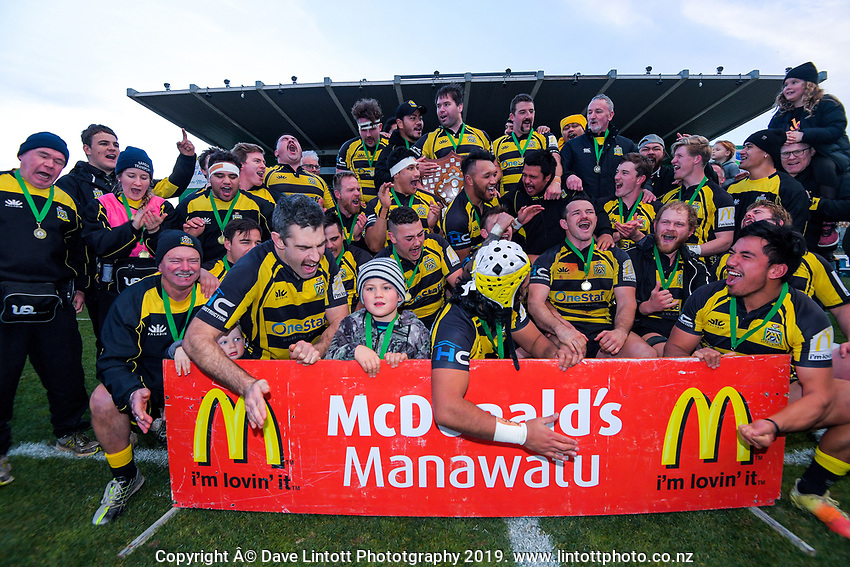 The Yellows team celebrates winning the 2019 Manawatu premier club rugby Hankins Shield final match between Varsity and Feilding Yellows at CET Arena in Palmerston North, New Zealand on Saturday, 13 July 2019. Photo: Dave Lintott / lintottphoto.co.nz