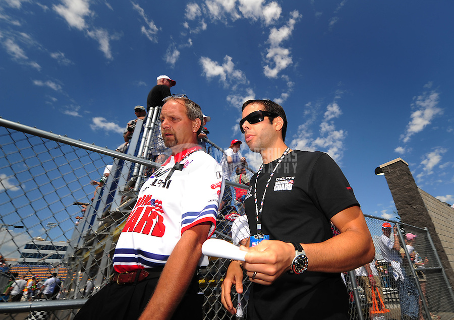Jun. 22, 2008; Newton, IA, USA; IRL driver Vitor Meira (right) walks through the paddock with a crew member prior to the Iowa Corn Indy 250 at the Iowa Speedway. Mandatory Credit: Mark J. Rebilas-