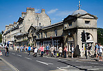 People shopping at shops on Pulteney Bridge, Bath, Somerset, England