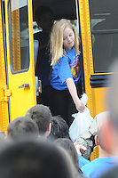 NWA Democrat-Gazette/FLIP PUTTHOFF <br /> Laci Taylor, fifth-grader at Elza Tucker Elementary in Lowell, hands food to classmates during the delivery of 3,800 food items Tuesday Nov. 24, 2015 at First Baptist Church in Lowell.