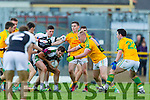Bernard Walsh South Kerry in action against Damien O'Sullivan Legion at the Kerry County Senior Football Final at Fitzgerald Stadium on Sunday.