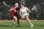 Los Angeles, CA 02/08/13 - Amanda Macaluso  (Northwestern #17) and Kelsey McGovern  (Umass #2) in action during the Northwestern vs UMass NCAA Women's Lacrosse game at USC's McAlister Field.