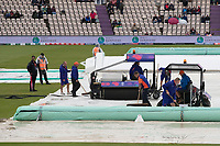 The ground staff continue the mopping up operation during South Africa vs West Indies, ICC World Cup Cricket at the Hampshire Bowl on 10th June 2019