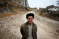 CHINA. Chongqing Province.  A man in the town of Wushan, which lies on the banks of the Yangtze and at the entrance to the 3 Gorges. As tourism booms, towns are being developed and modernized resulting in old areas being razed.  The flooding of the three Gorges, by damming the Yangtze near the town of YiChang, has remained a controversial subject due to the negative environmental consequences and the displacement of millions of people in the flood plain. The Yangtze River however is reported to be at its lowest level in 150 years as a result of a country-wide drought. It is China's longest river and the third longest in the world. Originating in Tibet, the river flows for 3,964 miles (6,380km) through central China into the East China Sea at Shanghai.  2008.
