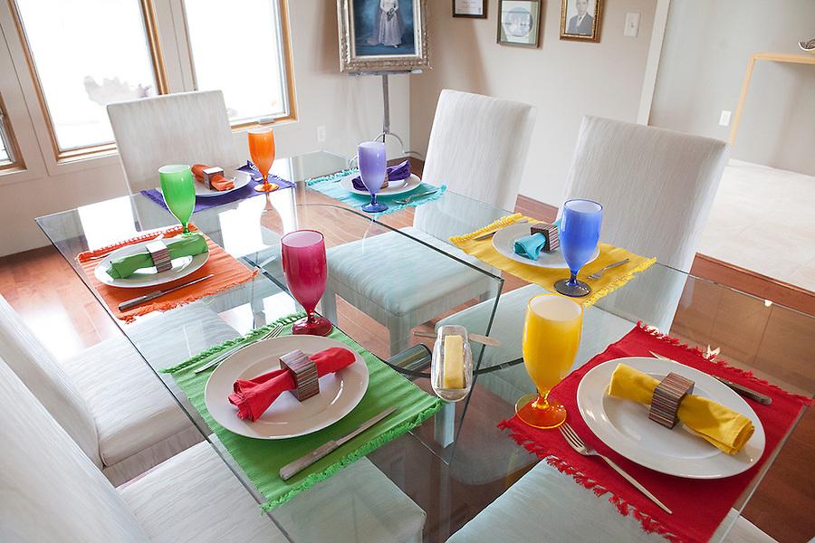 Colorful table setting  in a modern home, Sanford Lake, Michigan, MI, USA