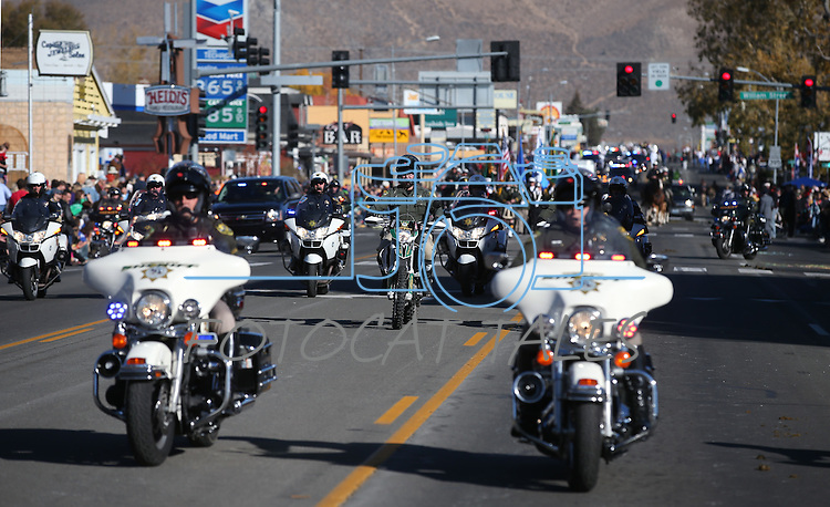 Carson City Sheriff's motor officers ride in the 75th annual Nevada Day parade in Carson City, Nev., on Saturday, Oct. 26, 2013.<br /> Photo by Cathleen Allison