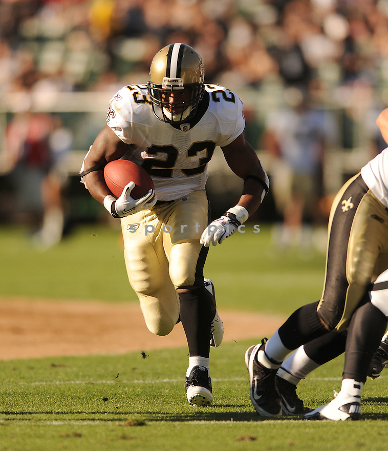 PIERRE THOMAS, of the New Orleans Saints, in action during the Saints game against the Oakland Raiders on August 28, 2011 at O.co Coliseum in Oakland, CA. The Saints beat the Raiders 40-20.