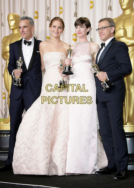 Daniel Day Lewis, Jennifer Lawrence, Anne Hathaway, Christoph Waltz.85th Annual Academy Awards held at the Dolby Theatre at Hollywood & Highland Center, Hollywood, California, USA..February 24th, 2013.pressroom oscars full length black tuxedo bow tie beard facial hair white shirt award trophy trophies winner winners white pink pale strapless dress trophies winners glasses .CAP/ADM.©AdMedia/Capital Pictures.