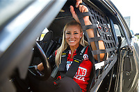 "Sep 2, 2016; Clermont, IN, USA; NHRA top fuel driver Leah Pritchett sits in her car prior to a charity match race against ""Papa John"" Schnatter (not pictured), founder of Papa Johns Pizza prior to qualifying for the US Nationals at Lucas Oil Raceway. Papa John's and Don Schumacher Racing put up $10,000 each for Riley's Hospital for Children, adding $20,000 to funds already raised through pizza sales earlier in the day. Mandatory Credit: Mark J. Rebilas-USA TODAY Sports"